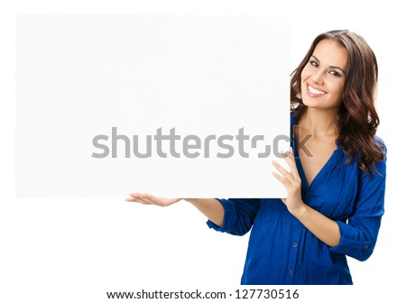 Happy smiling beautiful young woman showing blank signboard or copyspace for slogan or text, isolated over white background - stock photo