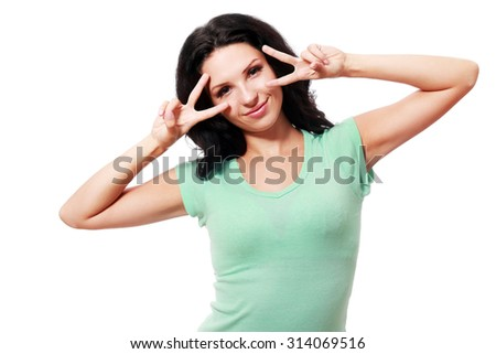 Happy smiling beautiful young woman showing two fingers or victory gesture, isolated over white background