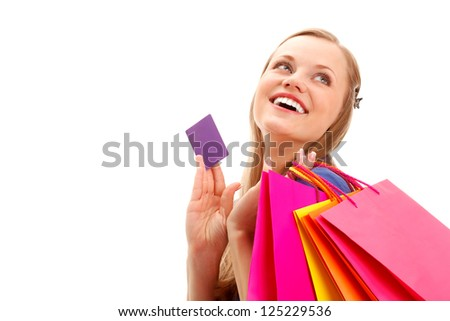 happy smiling blonde woman with shopping bags and blank  business card over white, copy space