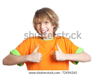 happy smiling boy, kid or teen with thumbs up