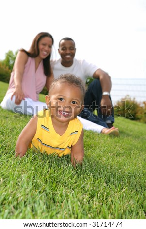 Happy smiling Boy Playing Outdoor with Parents In Summer Sunny Day - stock photo