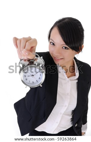 Happy smiling business girl holding alarm clock on white background, closeup portrait.