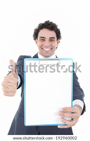 happy smiling business man  in suit holding up a banner or notes against a white background and showing with his hand blank space for message. Cardboard placard is blank ready for your message. - stock photo