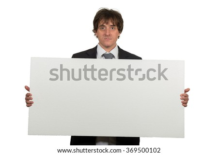 Happy smiling business man showing blank signboard, isolated over white background.