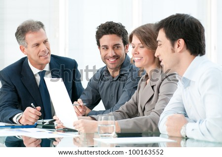 Happy smiling business team working together at office - stock photo