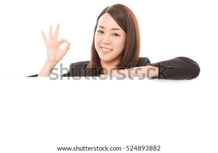 Happy smiling business woman showing ok sign on white board