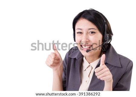 happy, smiling business woman showing two thumbs up gesture with headset - stock photo