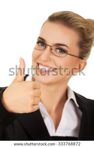 Happy smiling business woman with ok hand sign. - stock photo