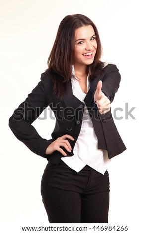 Happy smiling business woman with thumbs up gesture  - stock photo