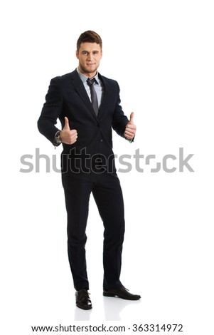 Happy smiling businessman with thumbs up.