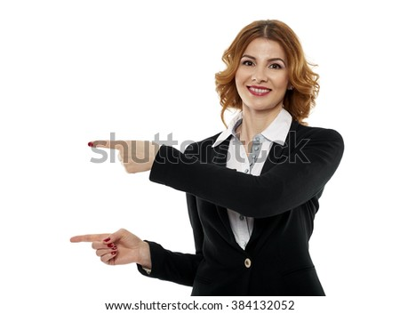 Happy smiling businesswoman pointing to the side of the image to an imaginary product