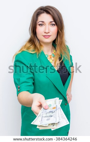 Happy smiling businesswoman wearing in green jacket with a big wallet and money. Closeup portrait super happy excited successful young business woman holding dollars
