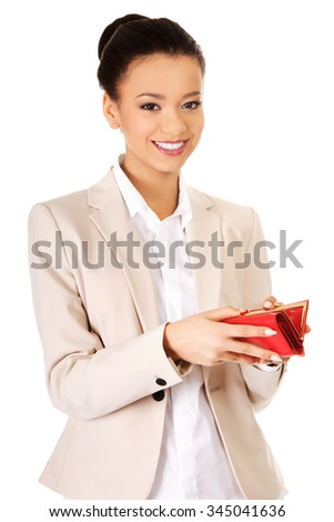 Happy smiling businesswoman with wallet.