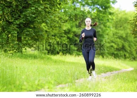 Happy Smiling Caucasian Sportwoman Having Her Regular Training Outdoors. Horizontal Image Orientation - stock photo