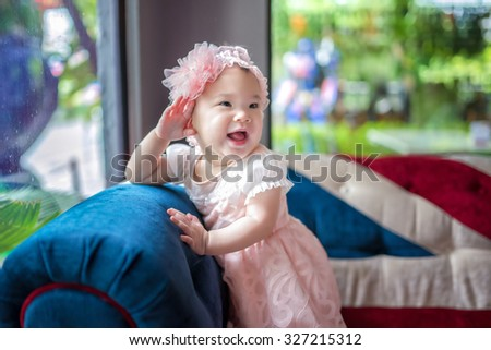 Happy smiling cheerful baby - stock photo