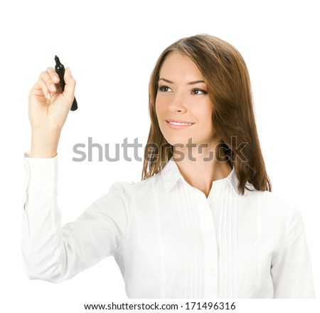Happy smiling cheerful beautiful young business woman writing or drawing something on screen with black marker, isolated over white background - stock photo