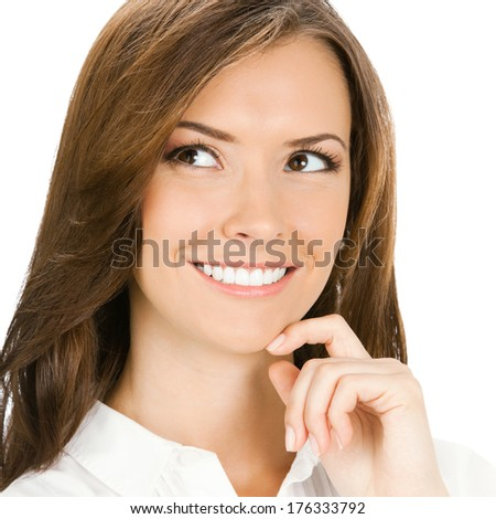 Happy smiling cheerful thinking or planning young business woman, isolated on white background