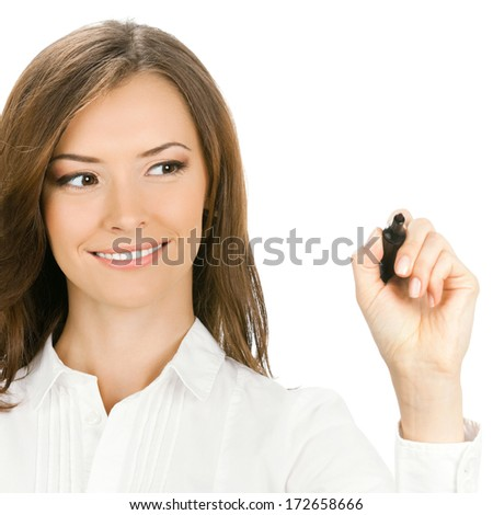 Happy smiling cheerful young business woman writing or drawing on screen with black marker, isolated on white background - stock photo