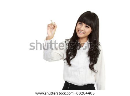 Happy smiling cheerful young business woman writing or drawing on screen with black marker isolated on white background - stock photo