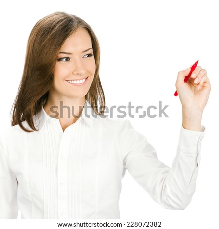 Happy smiling cheerful young business woman writing or drawing something on screen with red marker, isolated on white background - stock photo