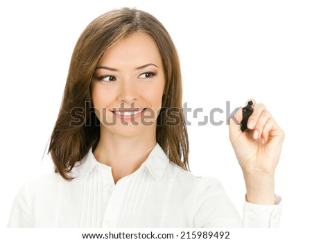 Happy smiling cheerful young businesswoman writing or drawing on screen with black marker, isolated on white background - stock photo