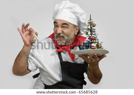 happy smiling chef  holds  New Year tree in hand