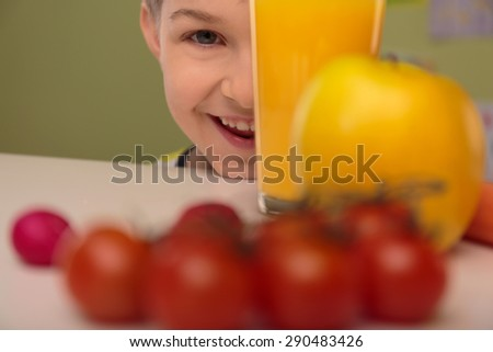 Happy smiling child and healthy food - stock photo