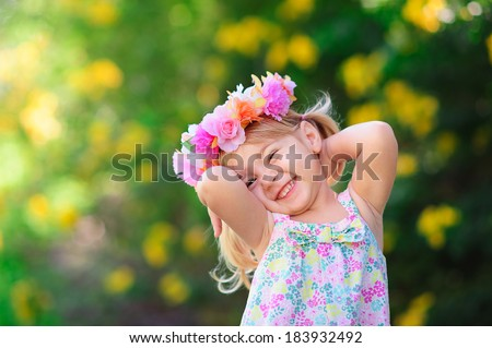 happy smiling child with flower at summer day outdoor - stock photo