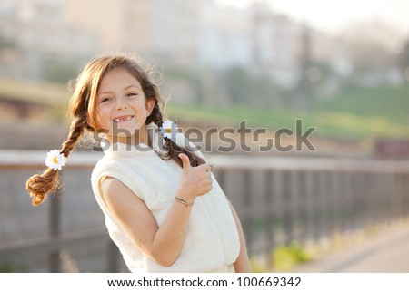 happy smiling, child with thumbs up - stock photo