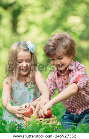 Happy smiling children playing outdoors in spring park. Picnic concept
