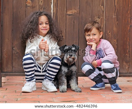 Happy smiling children with dog
