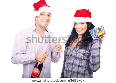 Happy smiling couple celebrate Christmas and holding champagne and gift isolated on white background
