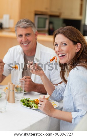 Happy smiling couple eating dinner together
