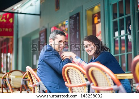 Happy smiling couple in an outdoor cafe