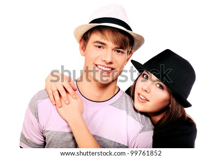 Happy smiling couple posing together. Isolated over white background.