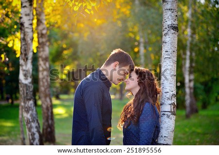 happy smiling couple walking in the park during the afternoon. concept about relationships. - stock photo