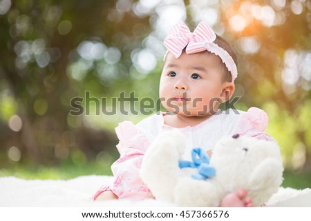happy smiling cute little girl child outdoors in summer day - stock photo