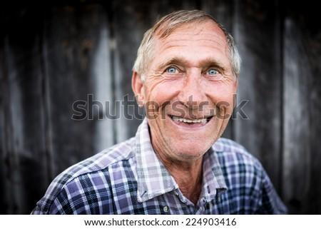 Happy smiling elder senior man portrait - stock photo