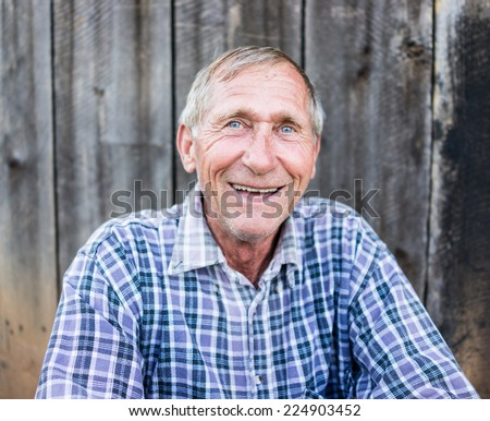 Happy smiling elder senior man portrait - stock photo