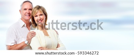 Happy smiling elderly couple over blue background