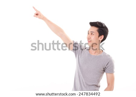 happy, smiling, exited man pointing finger up, white isolated background - stock photo