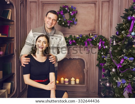 Happy smiling family at home celebrating Christmas  - stock photo