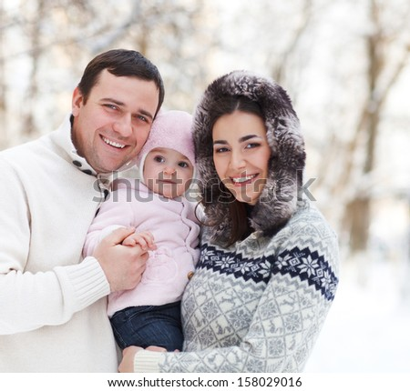 Happy smiling family with at the winter. Outdoors - stock photo