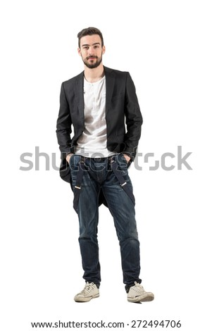 Happy smiling fashion model with hands in pockets. Full body length portrait isolated over white background.  - stock photo
