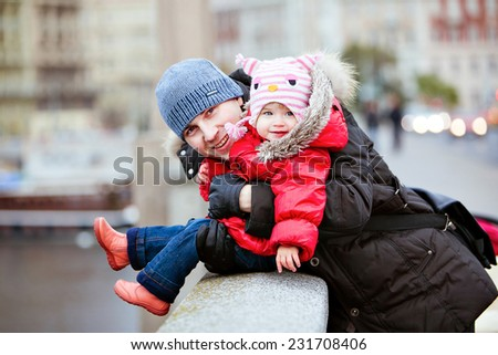 Happy smiling father and daughter in the background of city lights - stock photo