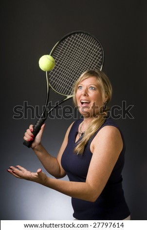 happy smiling female tennis player with racquet and ball healthy lifestyle concept  serving ball in air - stock photo