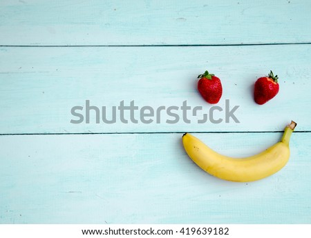 Happy smiling fruit face - stock photo