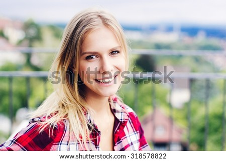 Happy Smiling girl in plaid shirt outdoors