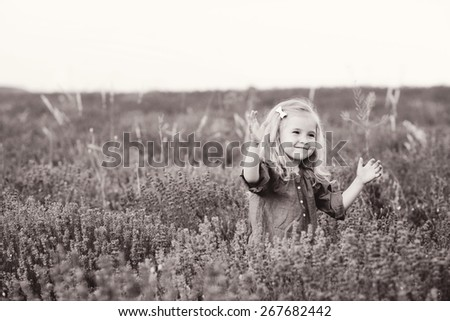 happy smiling girl in the lavender field - stock photo