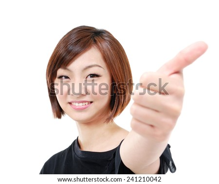 Happy smiling girl with thumbs up gesture,  - stock photo